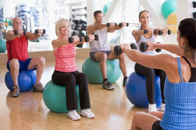 Low Impact Exercise Benefits | Safe & Smart Fitness - Using hand weights while sitting on exercise balls