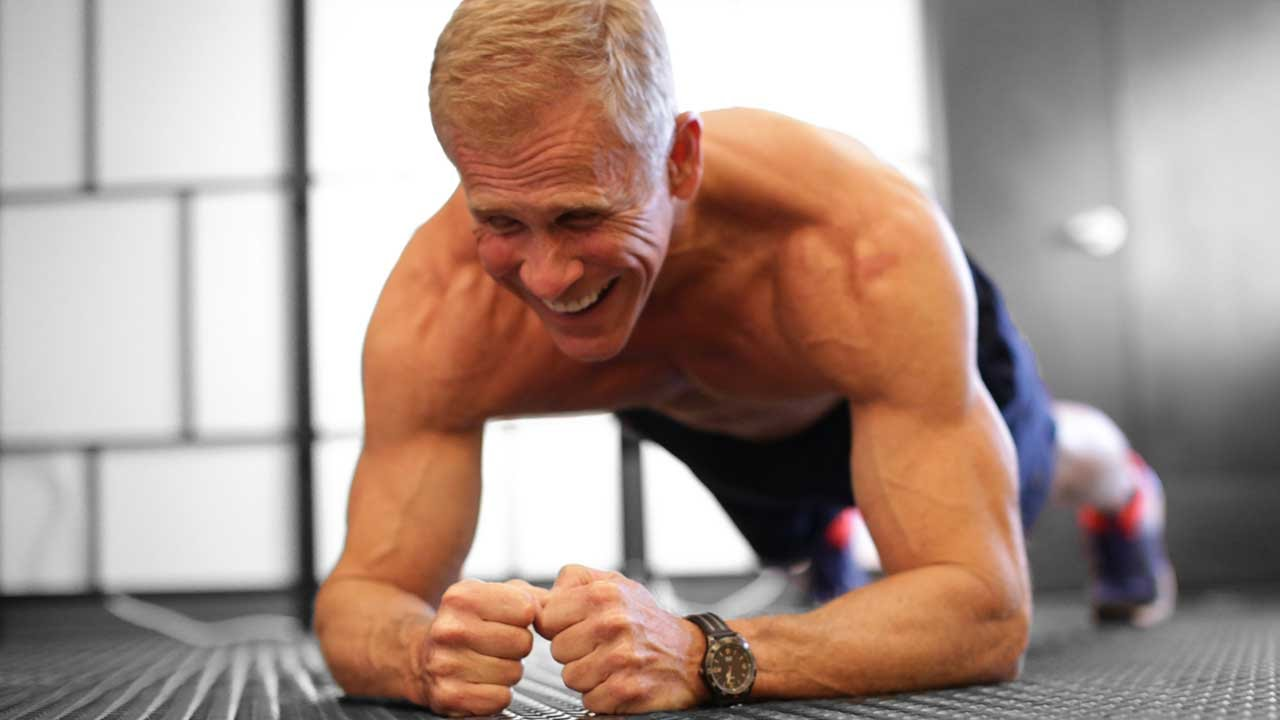 Gaining Muscle Over 50 - Older Man Doing a Plank