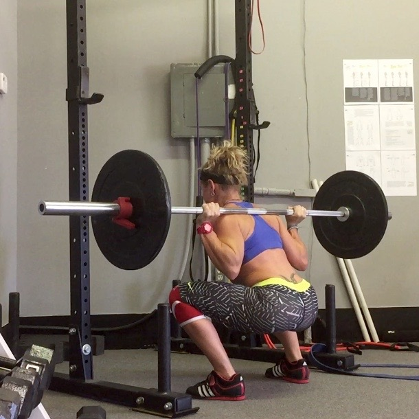 Woman Low Bar Squatting